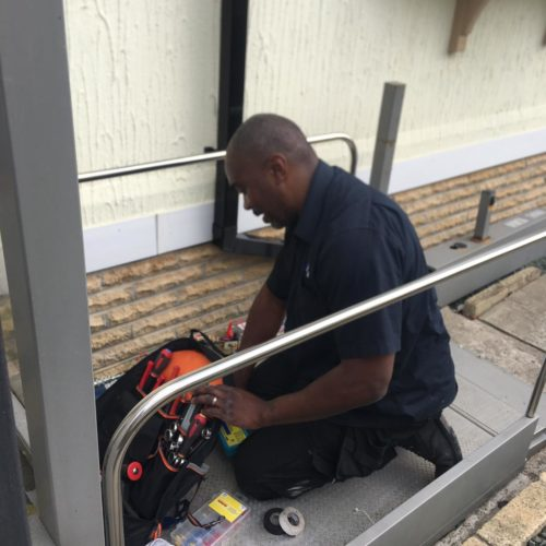 AMS workman maintaining outdoor stairlift