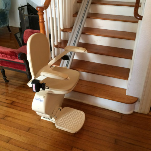 Stationary stairlift at the bottom of staircase