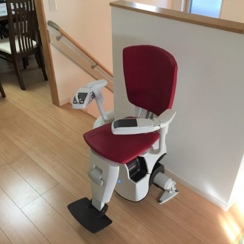 stairlift parked at the top of stairs