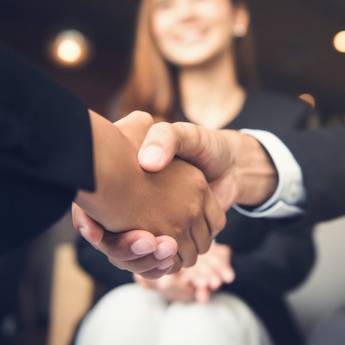 Businessmen making handshake with his partner in cafe - business etiquette, congratulation, merger and acquisition concepts